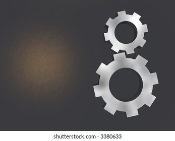Two mechanical gears of their chrome plated metal, on dirty metal surfaces