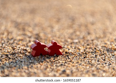 two meeples on the shore