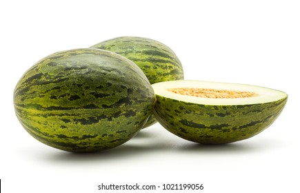 Two melons Piel de Sapo with one section half (Santa Claus Christmas variety) isolated on white background green striped outer rind