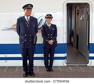Two members of staff from the Shinkansen Bullet Train in Japan, taken on April 7, 2012 at Mishima Train Station in Japan on the journey from Tokyo to Osaka.