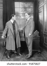 Two men arguing with each other