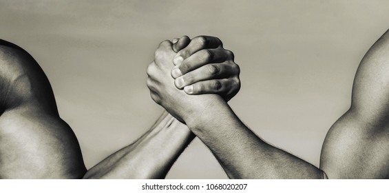 Two men arm wrestling. Arms wrestling, competition. Leadership concept, arm. Two muscular hands. Rivalry concept. Hand, rivalry, vs, challenge, strength comparison. Man hand. Black and white