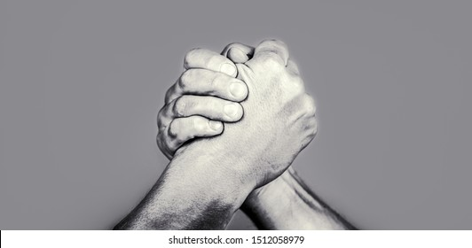 Two men arm wrestling. Arms wrestling. Friendly handshake, friends greeting. Handshake, arms, friendship. Hand, rivalry, vs challenge strength comparison Closep up Black and white