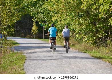 Two men biking in a trail