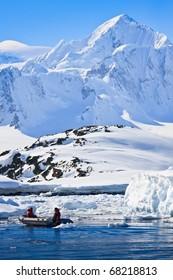two men in the boat in Antarctica fishing