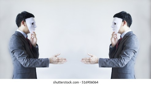 Two men in business suit handshaking with masks on - Business fraud and hypocrite agreement.