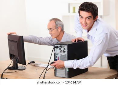 Two men with a computer