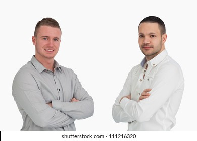 Two men crossing arms and standing side by side against a white background