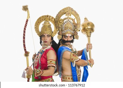 Two men dressed-up as Rama and Ravana the Hindu mythological characters