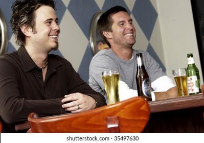 two men drinking at bar