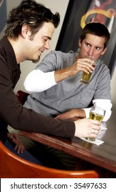 two men drinking at bar