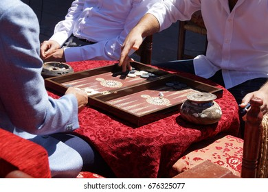 Two men enjoying a game of backgammon (tavla) in a teahouse  in Istanbul, Turkey