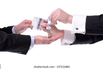 two men exchanging keys for money isolated on white background