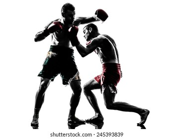 two  men exercising thai boxing in silhouette studio on white background
