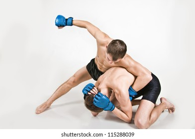 Two men fighting on a white background