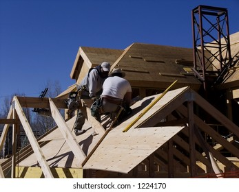 two men framing a house