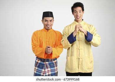 Two men greeting to people
