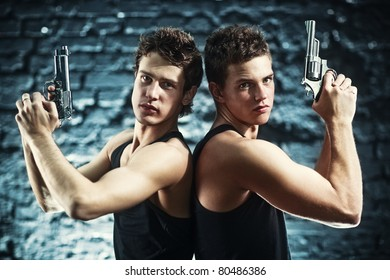 Two men with guns portrait.