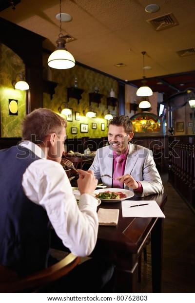 Two men having lunch in a restaurant