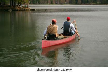 two men head out for a day of fishing in their canoe
