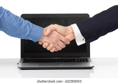 two men with laptop shaking hands