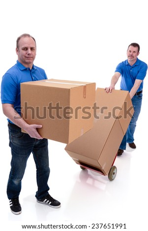 Two men moving boxes
