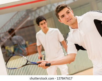Two men playing a match of squash
