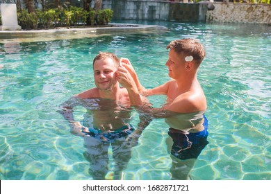 Two men in the pool. Love and romance.