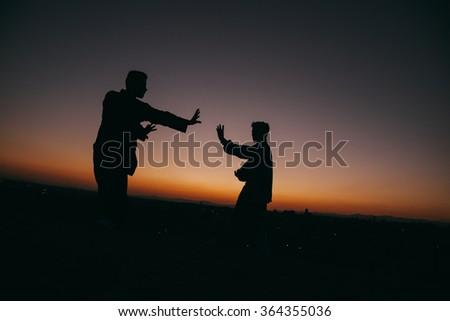 Two Men Practising Wushu