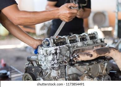 Two men  repair Old engine