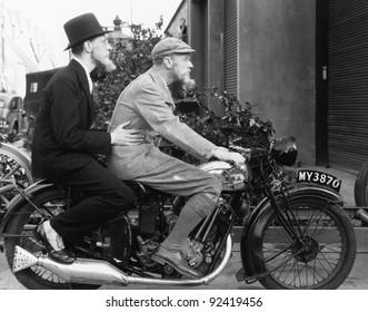 Two men riding a motorbike