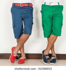 two men in shorts green and blue colors on white background