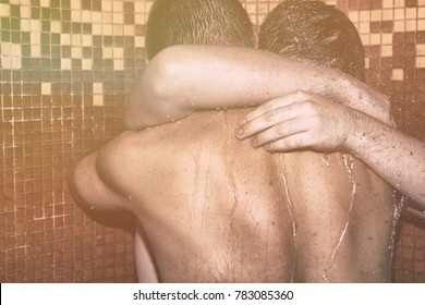 Two men in the shower. Love and romance.