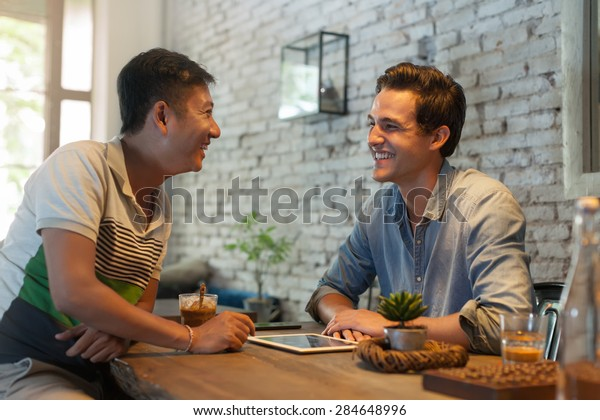 Two Men Sitting at Cafe, Asian Mix Race Friends Guys Happy Smile Natural Light