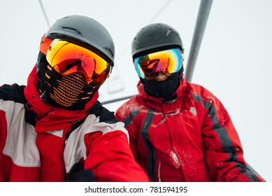 two men in a ski outfit helmet and mask