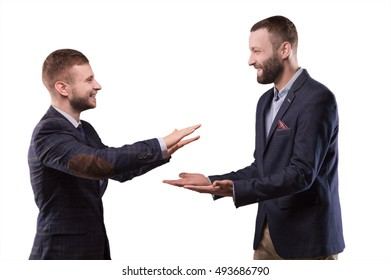 Two men slapping each other's hands and smiling