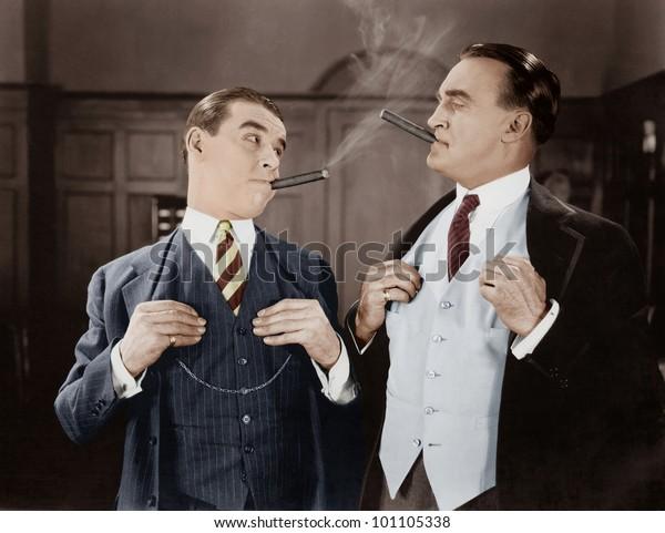 Two men smoking cigars