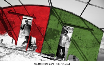 Two men standing around the doors of a colourful metallic boat