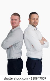 Two men standing back to back against a white background