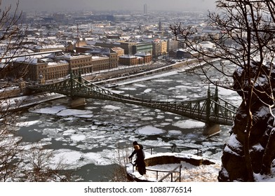 Two men standing on the terrace over frozen Danube in Budapest, Hungary