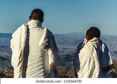 Two men stare out into the vast wilderness of the Ethiopian countryside.
