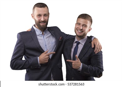 Two men in suits hugging and point the finger at each other