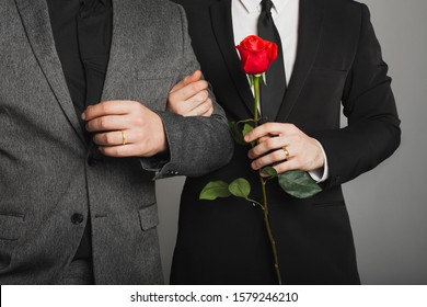 Two men in suits at the LGBTQ wedding