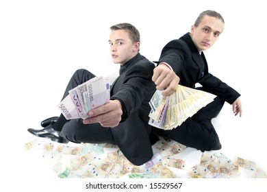 Two men in suits with a lot of money