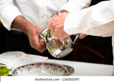 Two men washing hands at Passover. Jewish tradition