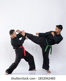 two men wearing pencak silat uniforms to fight on a white background