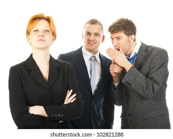 two men are whispering behind the back of a colleague