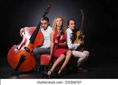 Two men and woman are playing jazz