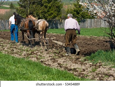 Two men working on the land