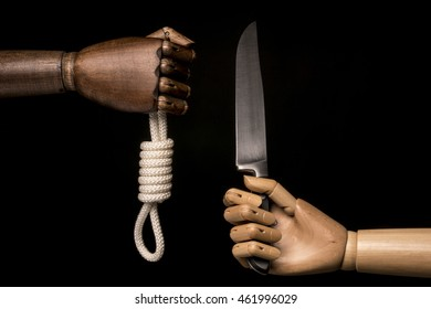 Two methods to commit suicide: the rope or the knife. Isolated on black background. With copy text.